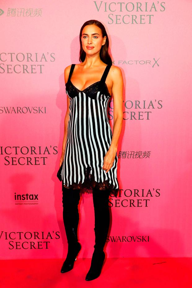Russian model Irina Shayk poses after taking part in the 2016 Victoria's Secret Fashion Show at the Grand Palais in Paris
