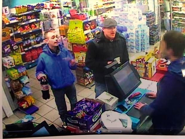 Louis Maguire, wearing a blue jacket, and Christopher Power buying mixers after they had been in Belfast city centre with Eamonn and were returning to Maguires house for drinks. Eamonn was waiting outside.