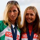 Olive Loughnane, on left, with Olga Kaniskina of Russia during the medal ceremony for 20km walk in Berlin in 2009. Photo: REUTERS/Wolfgang Rattay