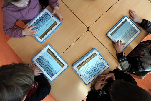 Thousands of schoolchildren now use iPads and tablets instead of textbooks. Photo: AFP/Getty Images