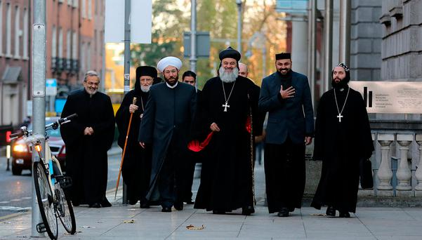 Dr Ahmad Badreddin Hassoun, the Grand Mufti of Syria (in white turban) and his delegation arriving at Leinster House for the Oireachtas Committee on Foreign Affairs to discuss the situation in Syria. Photo: Tom Burke