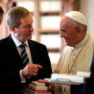 Pope Francis exchanges gifts with Taoiseach Enda Kenny during an audience in his private studio at the Vatican this week Photo: AP Photo/Alessandra Tarantino, pool