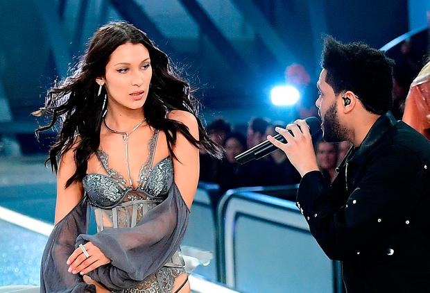 Bella Hadid and The Weeknd during the Victoria's Secret fashion show, held at The Grand Palais in Paris, France.