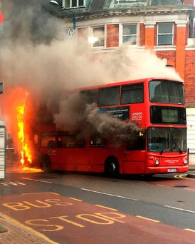 Bus on fire in Kingston, south west London: Hannah Page/PA Wire