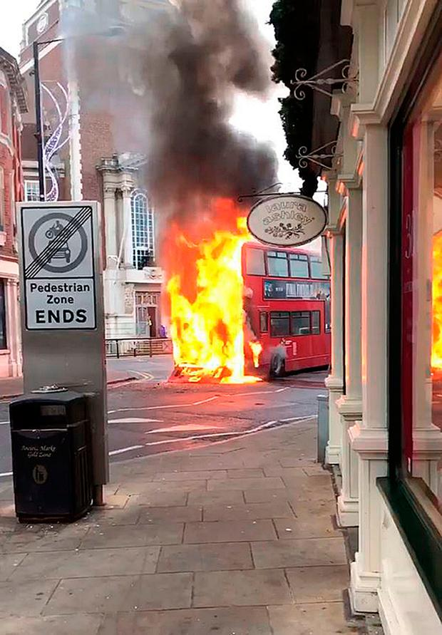 Bus on fire in Kingston, south west London Credit: @MPSKingston/PA Wire