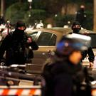 Special French police brigade secure a street near the travel agency where a gunman has taken hostage about half a dozen people in what appears to be a robbery, a police source said, in Paris, France. Picture: REUTERS/Charles Platiau