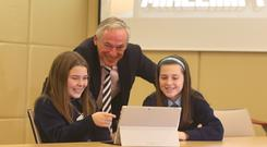 Education Minister Richard Bruton with Rachel Doherty (left) and Georgia Gammell, 6th class students from St Olaf's National School, Sandyford, taking part in a 'Minecraft Hour of Code' class at Microsoft's offices. Photo: Damien Eagers