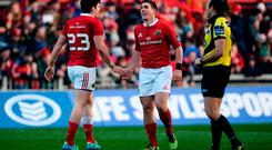 Alex Wootton of Munster celebrates with team-mate Ian Keatley