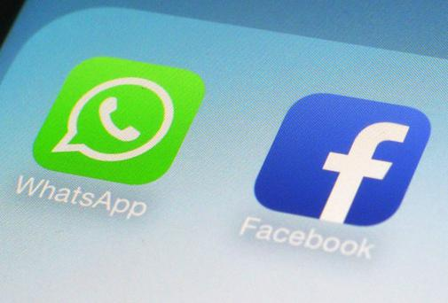 Photo shows the WhatsApp and Facebook app icons on an iPhone in New York.