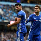 MANCHESTER, ENGLAND - DECEMBER 03: Diego Costa (1st R) of Chelsea points his black armband to commemorate the victims of the plane crash involving the Brazilian club Chapecoense after scoring his team's first goal during the Premier League match between Manchester City and Chelsea at Etihad Stadium on December 3, 2016 in Manchester, England. (Photo by Darren Walsh/Chelsea FC via Getty Images)