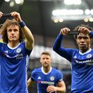 MANCHESTER, ENGLAND - DECEMBER 03: Willian (R) of Chelsea holds up the black armband to commemorate the victims of the plane crash involving the Brazilian club Chapecoense along with his team mate David Luiz after scoring his team's second goal during the Premier League match between Manchester City and Chelsea at Etihad Stadium on December 3, 2016 in Manchester, England. (Photo by Darren Walsh/Chelsea FC via Getty Images)