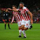 STOKE ON TRENT, ENGLAND - DECEMBER 03: Jonathan Walters (R) of Stoke City celebrates scoring his team's first goal with his team mates Xherdan Shaqiri (L) during the Premier League match between Stoke City and Burnley at Bet365 Stadium on December 3, 2016 in Stoke on Trent, England. (Photo by Alex Livesey/Getty Images)