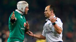 Ireland captain Rory Best questions a decision by referee Jaco Peyper. Photo: Phil WalterGetty Images