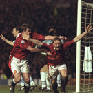 David May (right) and Gary Pallister celebrate after May scored the opening goal in the Champions League Quarter Final First Leg against Porto, March 1997. United won 4-0. Photo: Getty/Shaun Botterill/Allsport