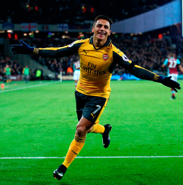 Arsenal's Alexis Sanchez celebrates scoring his side's second goal. Photo: PA