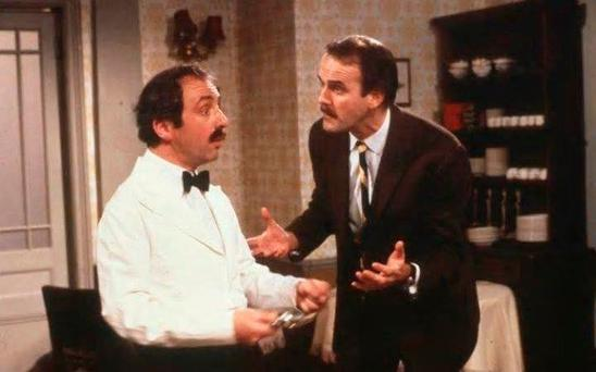 HE'S FROM BARCELONA: Andrew Sachs (left) as the hapless waiter Manuel and John Cleese as Basil Fawlty in an episode of 'Fawlty Towers' Photo: PA/BBC