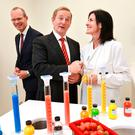 Taoiseach Enda Kenny and the then Minister for Agriculture and Food Simon Coveney with food flavorist Aine Walsh in one of the Kerry Group food-development labs in Naas last year Photo: Frank Mc Grath