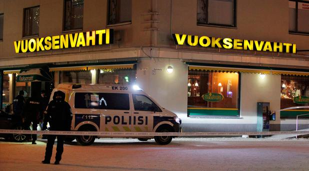 Police guards the area were three people were killed in a shooting incident at a restaurant in Imatra, eastern Finland, after midnight on December 4, 2016. / AFP PHOTO / Lehtikuva / Lauri Heino / Finland OUTLAURI HEINO/AFP/Getty Images