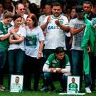 Relatives of the members of Brazilian team Chapecoense Real pay a tribute at the club's Arena Conda stadium in Chapeco