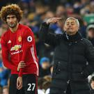 LIVERPOOL, ENGLAND - DECEMBER 04: Jose Mourinho manager of Manchester United stands alongside substitute Marouane Fellaini of Manchester United during the Premier League match between Everton and Manchester United at Goodison Park on December 4, 2016 in Liverpool, England. (Photo by Clive Brunskill/Getty Images)