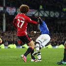 LIVERPOOL, ENGLAND - DECEMBER 04: Marouane Fellaini of Manchester United fouls Idrissa Gueye of Everton in the penalty box during the Premier League match between Everton and Manchester United at Goodison Park on December 4, 2016 in Liverpool, England. (Photo by Chris Brunskill - AMA/Getty Images)