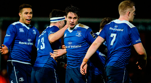 Leinster out-half Joey Carbery, centre, is congratulated by his team-mates after scoring his side's fourth try. Photo: Seb Daly/Sportsfile