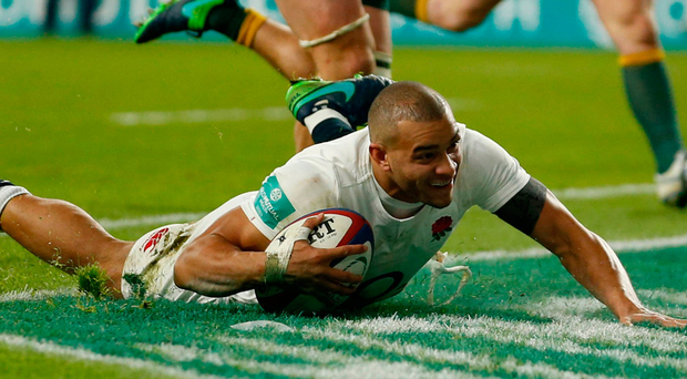 Jonathan Joseph goes over for England's fourth try during the Autumn International match at Twickenham. Photo: Paul Harding/PA