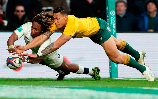 England's Marland Yarde scores a try despite the efforts of Australia's Israel Folau. Photo: David Davies/PA