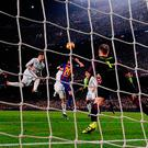 The Barcelona defence is marked absent as Sergio Ramos equalises for Real Madrid in the dying minutes at the Nou Camp. Photo: Getty