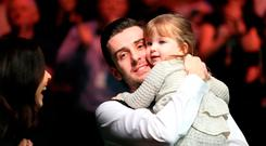 Mark Selby celebrates his victory over Ronnie O'Sullivan with his daughter Sofia Maria and wife Vikki Layton during day twelve of the Betway UK Championships 2016, at the York Barbican. PRESS ASSOCIATION Photo. Picture date: Sunday December 4, 2016. See PA story SNOOKER York. Photo credit should read: Mike Egerton/PA Wire