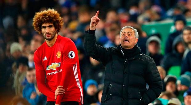 Jose Mourinho and Marouane Fellaini. Photo: Getty