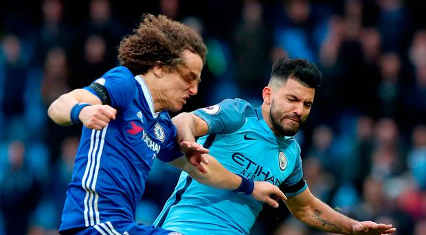 Sergio Aguero commits his X-rated foul on David Luiz. Photo: PA