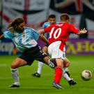 Michael Owen (No.10) of England is tackled in the penalty area by Mauricio Pochettino (No.4) in 2002