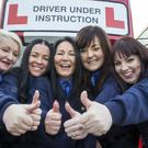 The first all-female class graduates from Dublin Bus (from left) Tracy O'Sullivan, Rachael Dunne, Elizabeth Cummins, Jennifer O'Donoghue and Sinead Hilliard pictured at The Dublin Bus Depot, Broadstone today. Pic Colin O'Riordan