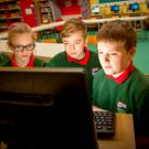 Yola, Kian and Calum, students from St Edward's National School in Sligo, working on a coding project at their school. Photo: James Connolly