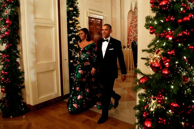 U.S. President Barack Obama and first lady Michelle Obama arrive at the Kennedy Center Honors Reception at the White House