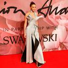 Model Gigi Hadid poses for photographers at the Fashion Awards 2016 in London