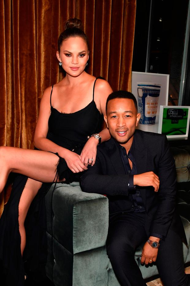 Chrissy Teigen, wearing the Audemars Piguet Millenary watch, (L) and John Legend, wearing the Audemars Piguet Royal Oak, host the celebration of MATERIAL GOOD's 1st Anniversary on December 6, 2016 in New York City. (Photo by Jamie McCarthy/Getty Images for Material Good)