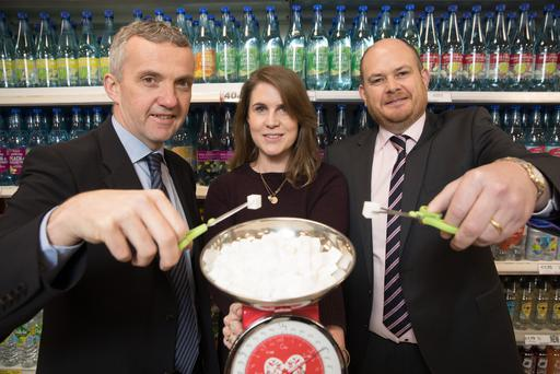 Picture shows from left Professor Donal O'Shea, Consultant Endocrinologist at St Vincent's University Hospital and St Columcilles Hospital; Alison O'Doherty Senior Buying Manager for Impulse at Tesco Ireland and Joe Manning Category Director at Tesco Ireland, announce reductions in sugar levels in Tesco's own brand soft drinks. The move makes Tesco the first retailer in Ireland to respond to the Government's A Healthy Weight for Ireland Plan.Pic:Naoise Culhane-no fee