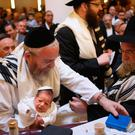 The circumcision ceremony of a baby at an Orthodox Jewish synagogue in Berlin, Germany. In 2013, a Cologne court sparked outrage among the country's Jewish and Muslim population by questioning the legality of the practice Getty Images