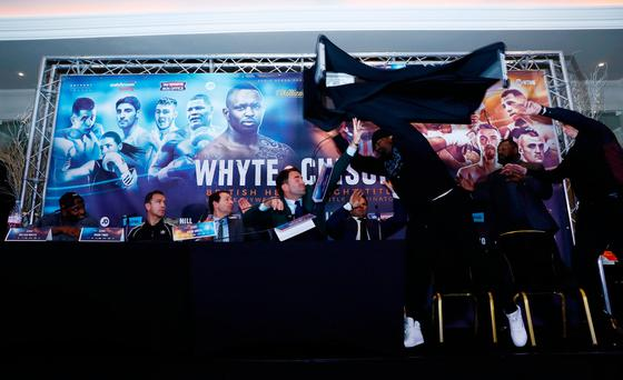 Boxer ends press conference by launching a table at opponent