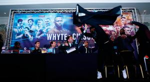 Dillian Whyte, trainer Mark Tibbs, Sky Sports' Adam Smith, promoter Eddie Hearn and promoter Kalle Sauerland look on as Dereck Chisora throws a table during the press conference Action Images via Reuters / Jason Cairnduff