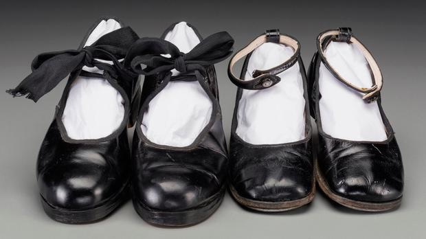 This undated photo provided by Heritage Auctions shows two pairs of tap shoes belonging to the child movie star Shirley Temple that sold at auction for $20,000 (Matt Roppolo/Heritage Auctions via AP)