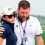 Anne-Lise Caudal is consoled by tournament director Michael Wood aftert her caddie collapsed and died during the first round of the Dubai Ladies Masters