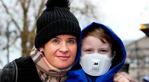 Stephanie Smyth from Lusk, Co Dublin, with her son Sam Mullen (7) who has cystic fibrosis at the protest at Leinster House. Photo: Tom Burke
