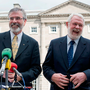 Sinn Fein President Gerry Adams and TD Martin Ferris speak to the media on the plinth at Leinster House in 2011