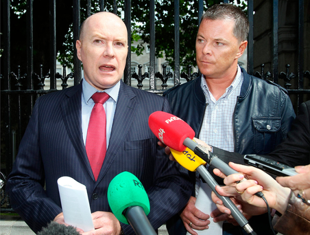 Austin Stack and his brother Oliver speak to the media outside Leinster House on an earlier occasion
