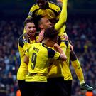 Borussia Dortmund's players celebrate their second goal. Photo: Susana Vera/Reuters