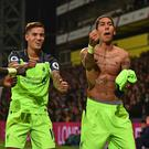 Liverpool's Brazilian midfielder Roberto Firmino (R) celebrates with Liverpool's Senegalese midfielder Sadio Mane (L) and Liverpool's Brazilian midfielder Philippe Coutinho after scoring their fourth goal during the English Premier League football match between Crystal Palace and Liverpool at Selhurst Park in south London on October 29, 2016. / AFP / Glyn KIRK /