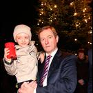 Taoiseach Enda Kenny holds Evan O'Brien (6) from Beaver Street whose mother died at the annual lighting of the Christmas Tree on Buckingham Street Pic Steve Humphreys
